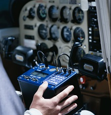 Pilot with ATS Radio Telemetry Receiver with integrated GPS used in cockpit of aerial wildlife tracking system aircraft